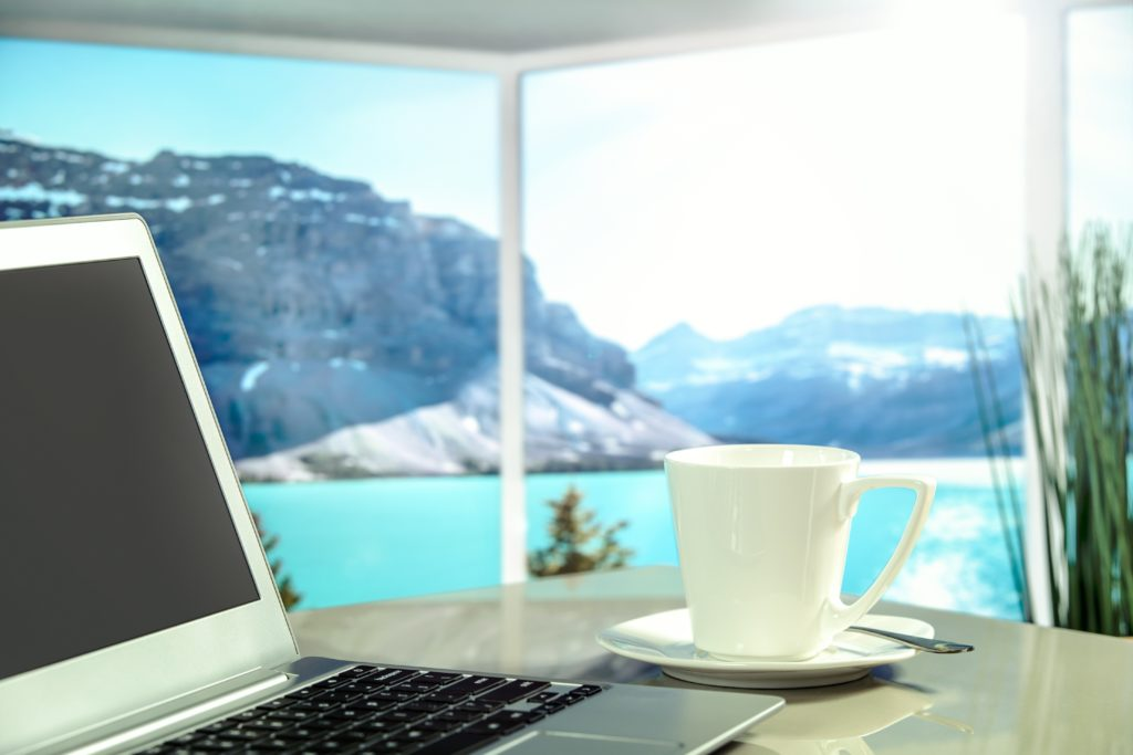 laptop with coffee and mountain view
