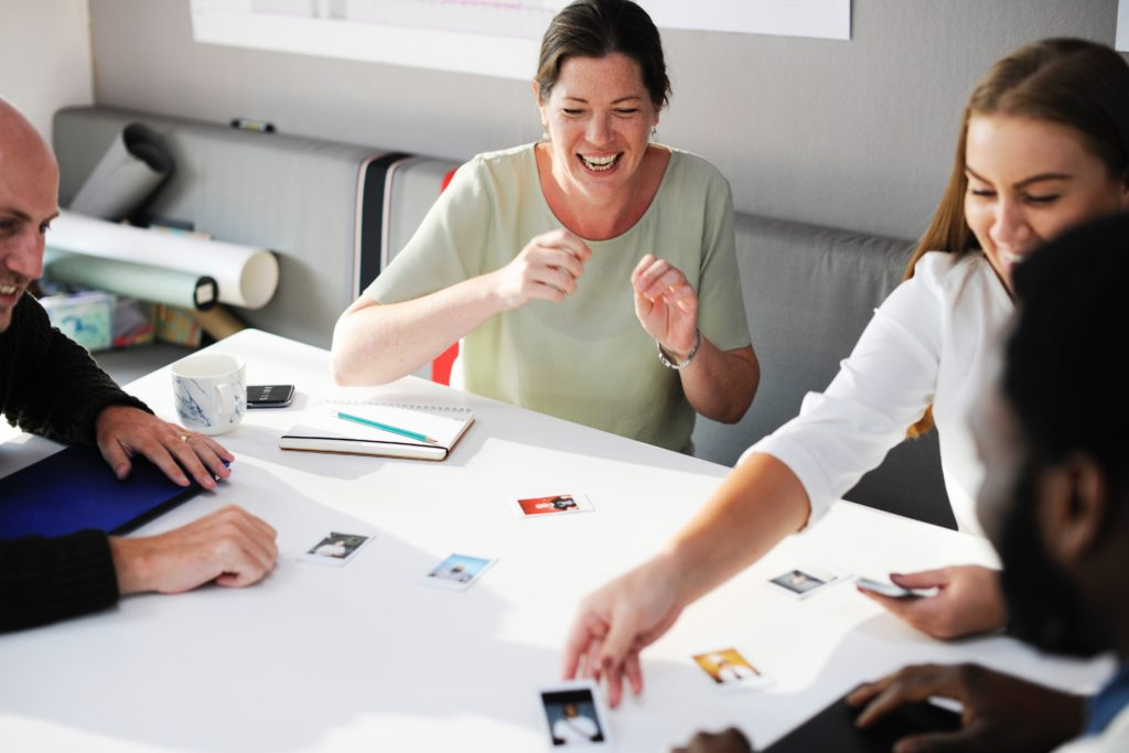 great office culture means happy employees - these are playing cards together