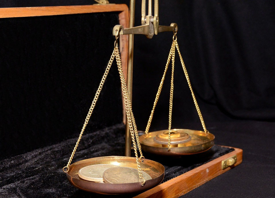 Weighing employee benefits - image of scale